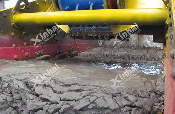 A picture shows the tailings dewatering process